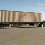 40' x 8' container loaded on a tilt-bed trailer