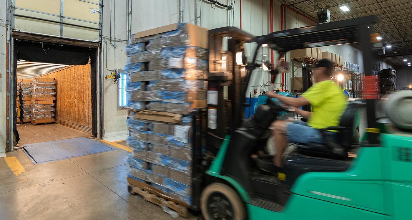 forklift at warehouse dock door