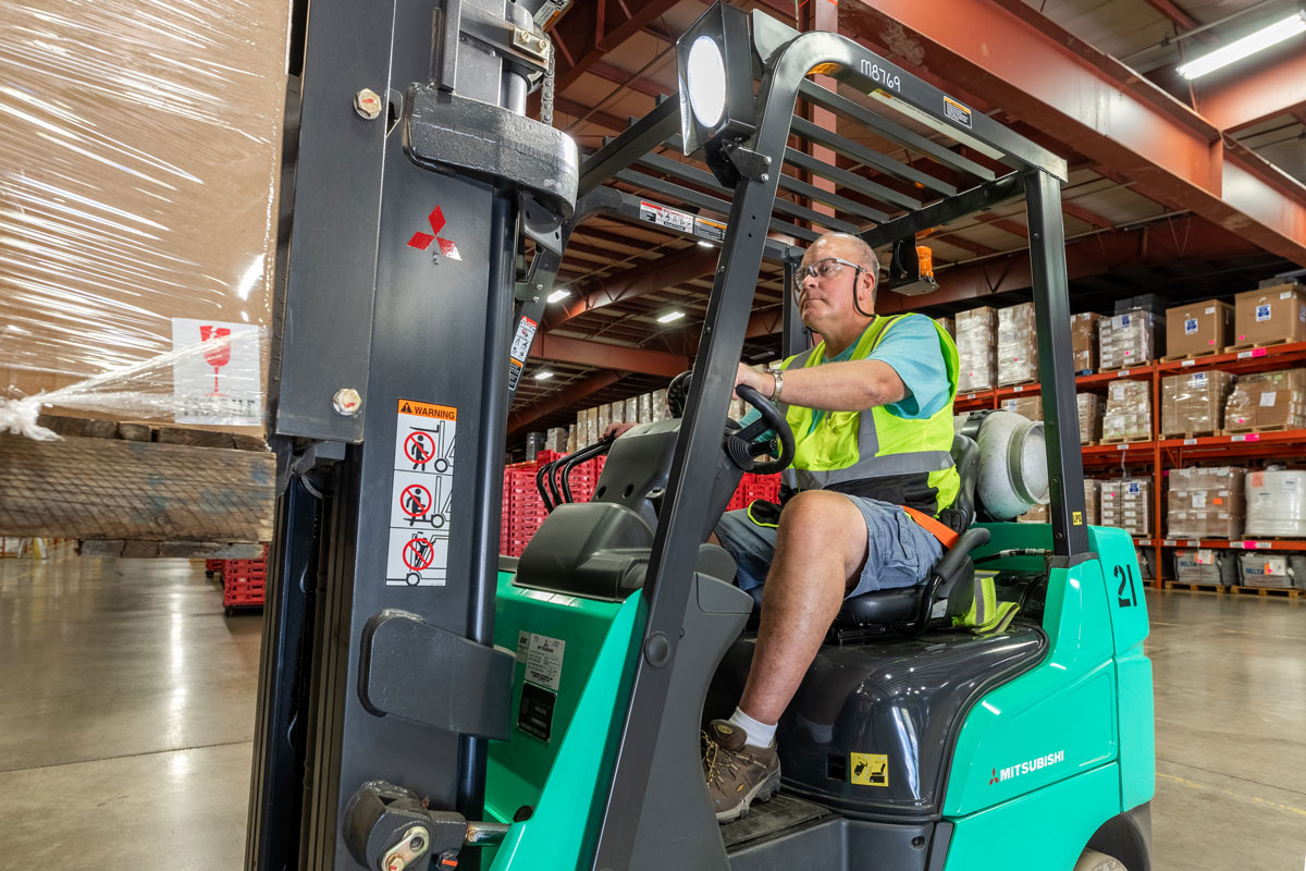 forklift driver in safety vest
