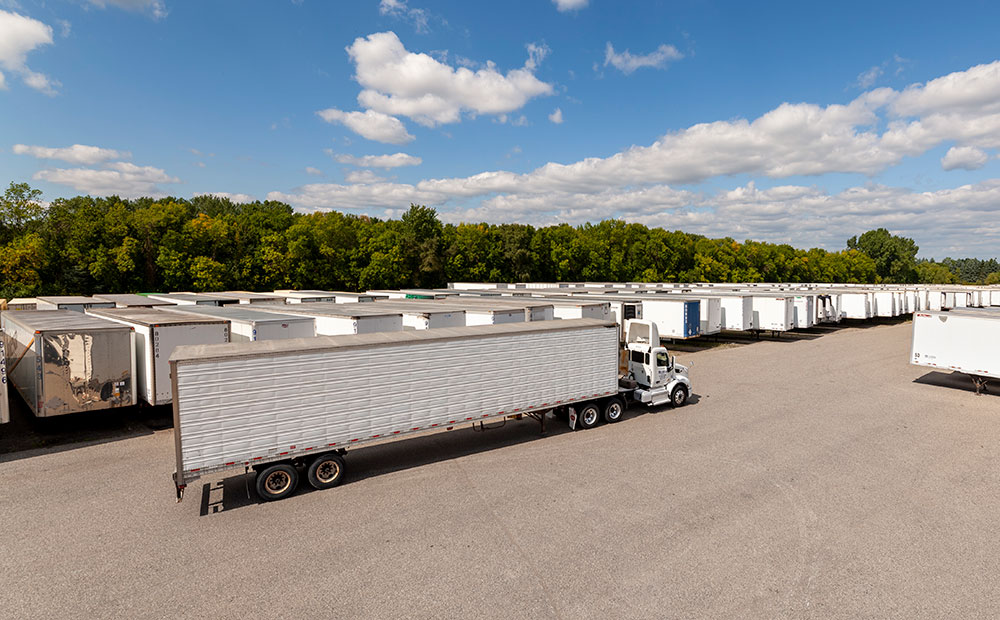 yard of storage trailers